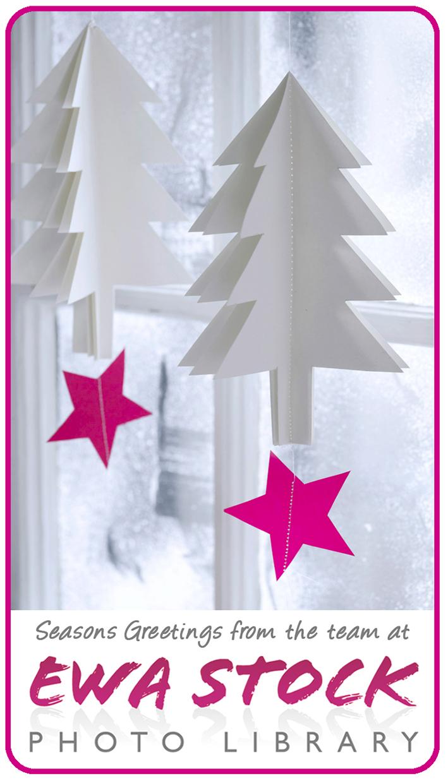 Paper Christmas tree decorations on window